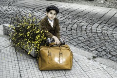 Child on a road with vintage bag Stock Photos