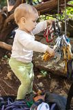 Child of rock climbers playing with quickdraws Royalty Free Stock Photography