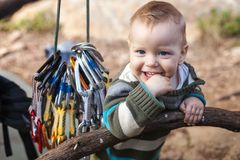 Child of rock climbers smiling while standing Royalty Free Stock Images