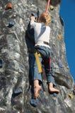 Child rock climbing Stock Image