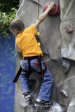 Child Rock climbing Stock Image
