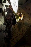 Child rock climbing up the wall Stock Images