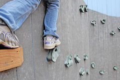 Child on rock climbing wall Stock Photo