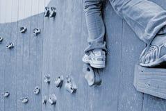 Child on rock climbing wall Royalty Free Stock Image