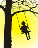 Child of rocker. Child rocking on the bench, hinged on the tree Royalty Free Stock Photos