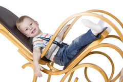 Child on a rocking chair Stock Image