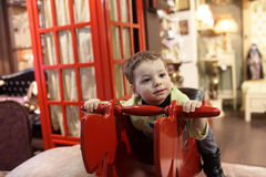 Child on a rocking horse Stock Photo