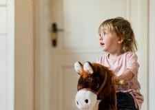 Child on rocking horse Royalty Free Stock Images