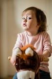 Child on rocking horse Stock Photos