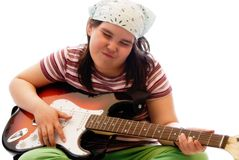 Child Rockstar. A young girl pretending to be a rockstar by playing an electric guitar Royalty Free Stock Photo