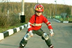 Child roller-skating Stock Photo