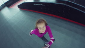 Child roller skating in park stock footage