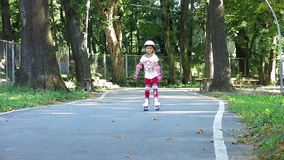 A Child On Rollers On a Track. . Sports Activity stock video footage