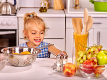 Child with rolling-pin dough Royalty Free Stock Photography