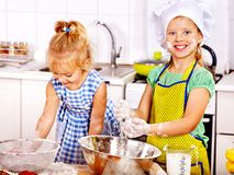 Child with rolling-pin dough Royalty Free Stock Photos