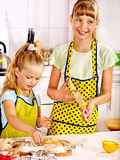 Child with rolling-pin dough Stock Photos