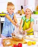 Child with rolling-pin dough Stock Image