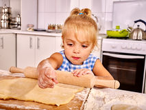 Child with rolling-pin dough Stock Images