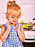 Child with rolling-pin dough Royalty Free Stock Image