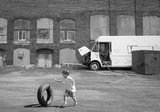 Child rolling a tire stock images