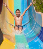 Child rolling with waterslides Stock Photography