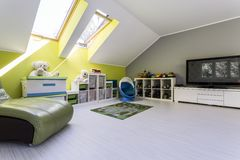 Child room at the attic with TV set Stock Photo