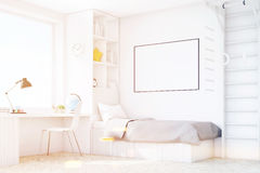 Child room with a bed and a table, corner, toned Stock Images