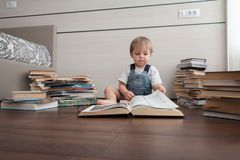 A child in a room with books. stock photography