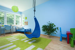 Child room with hanging chair Stock Photo