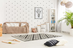 Child room with plant. White child room with green plant, couch, carpet, bookcase, toys Stock Photo