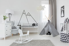 Child room with white furniture. Carpet, tent and wall sticker Royalty Free Stock Photo