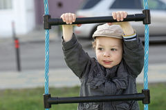 Child on a rope ladder. At playground Stock Image