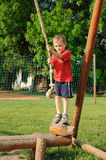 Child on rope swing Royalty Free Stock Image