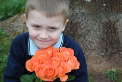 Child with roses. Little, blonde boy with roses for his Mum stock photos