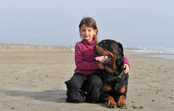 Child and rottweiler Stock Photography