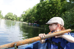Child rowing boat Royalty Free Stock Images