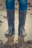 Child In Rubber Boots Stock Image