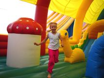 Child running in bouncy castle Royalty Free Stock Photo