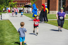 Child runner completes 5K charity walk/run. Corvallis, OR, May 7 2016: Child runner completes  5K walk-and-run for Center Against Rape and Domestic Violence Royalty Free Stock Images