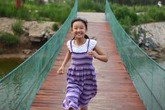 Child running. On the bridge Stock Photography
