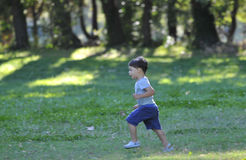 Child running. A child running in a field by a sunny day of summer in the countryside stock photo