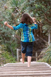 Child running away Royalty Free Stock Image