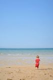 Child running on the beach Royalty Free Stock Photos