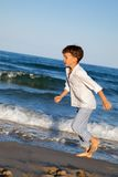 Child are running on beach Stock Photography