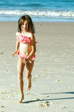 Child running on beach Stock Photo