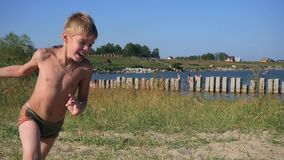 Child running on beach sand