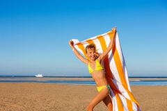 Child running at beach with towel Royalty Free Stock Photography