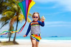 Child with kite. Kids play. Family beach vacation. Stock Photography