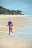 Child running on exotic beach Royalty Free Stock Image
