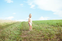 Child running in a field Stock Photos